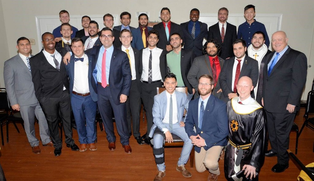 ded5bc92df939 Zeta Chi alumni join the chapter s graduating seniors for the Affirmation of  Knighthood ceremony.